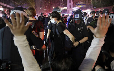 Police arrest protesters as they march through the streets of Manhattan, New York, June 3, 2020. (AP/Seth Wenig)