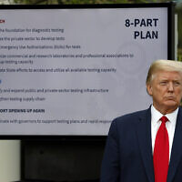 US President Donald Trump listens during briefing about the coronavirus in the Rose Garden of the White House in Washington, April 27, 2020. (AP Photo/Alex Brandon, File)