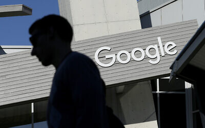 A man walks past a building on the Google campus in Mountain View, California, November 12, 2015. (AP Photo/Jeff Chiu, File)