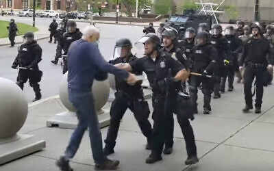 In this image from video provided by WBFO, a Buffalo police officer appears to shove a man who walked up to police on June 4, 2020, in Buffalo, New York. (Mike Desmond/WBFO via AP)