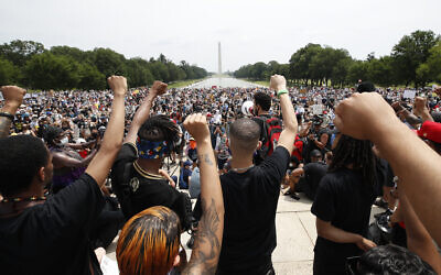 Demonstrators protest on June 6, 2020, at the Lincoln Memorial in Washington, over the death of George Floyd, a black man who was in police custody in Minneapolis. Floyd died after being restrained by Minneapolis police officers. (AP/Alex Brandon)