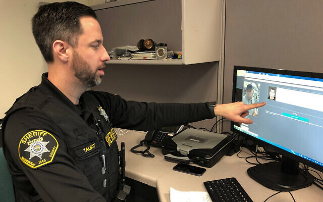 Washington County Sheriff's Office Deputy Jeff Talbot demonstrates how his agency used facial recognition software to help solve a crime, at its headquarters in Hillsboro, Oregon, February 22, 2019. (Gillian Flaccus/AP)