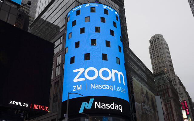A photo of a sign for Zoom Video Communications ahead of its Nasdaq IPO in New York, April 18, 2019. (AP Photo/Mark Lennihan, File)