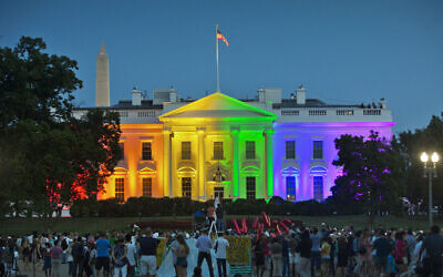 In this Friday, June 26, 2015 file photo, people gather in Lafayette Park to see the White House illuminated with rainbow colors in commemoration of the Supreme Court's ruling to legalize same-sex marriage in Washington. (AP/Pablo Martinez Monsivais)
