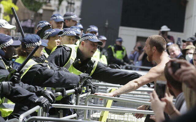 British police officers, left, scuffle with members of far-right groups protesting against a Black Lives Matter demonstration, in central London, June 13, 2020. (AP Photo/Kirsty Wigglesworth)