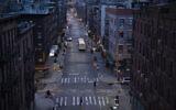 Bicyclists and a pedestrian pass through a quiet Manhattan street, March 26, 2020, during the coronavirus pandemic in New York. (AP Photo/Mark Lennihan)