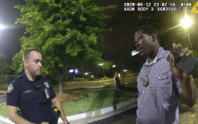 This screen grab taken from body camera video provided by the Atlanta Police Department shows Rayshard Brooks speaking with Officer Garrett Rolfe in the parking lot of a Wendy's restaurant, late Friday, June 12, 2020, in Atlanta. (Atlanta Police Department via AP)