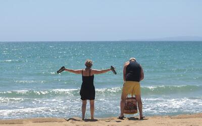 German tourists arrive at the beach of Palma de Mallorca, Spain, June 15, 2020. (Joan Mateu/AP)