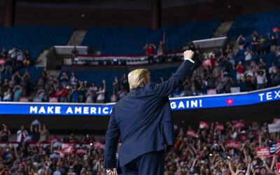 US President Donald Trump arrives on stage to speak at a campaign rally at the BOK Center, June 20, 2020, in Tulsa, Oklahoma. (AP Photo/Evan Vucci)