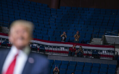 US President Donald Trump supporters cheer as Trump speaks during a campaign rally at the BOK Center, Saturday, June 20, 2020, in Tulsa, Okla. (AP Photo/Evan Vucci)