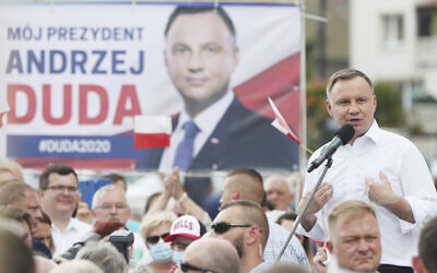 Polish President Andrzej Duda waves to supporters as he campaigns for a second term in Serock, Poland, June 17, 2020. (Czarek Sokolowski/AP)