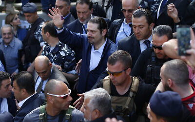In this Sunday, May 8, 2016 file photo, Former Lebanese Prime Minister Saad Hariri, center, leader of Lebanon's parliamentary majority, waves to his supporters after he voted at a polling station during the municipal elections in Beirut, Lebanon. An explosion occurred earlier in June 2020 near the convoy of former Lebanese Prime Minister Saad Hariri when he was on a visit in a mountainous region in Lebanon's eastern Bekaa Valley, a Saudi-owned TV station reported Sunday, June 28. (AP Photo/Hassan Ammar)