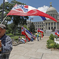 """I love this flag,"" states David Flynt of Hattiesburg, while standing outside the state Capitol with other current Mississippi flag supporters in Jackson, Miss., Sunday, June 28, 2020. Lawmakers in both chambers voted for state flag change legislation today. Mississippi Governor Tate Reeves has already said he would sign whatever flag bill the Legislature decides on.  (AP Photo/Rogelio V. Solis)"