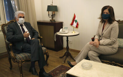 Lebanese Foreign Minister Nassif Hitti, left, meets with US Ambassador to Lebanon Dorothy Shea, in Beirut, Lebanon, June 29, 2020 (AP Photo/Hussein Malla)