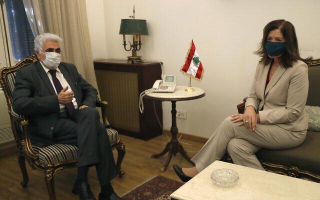 Lebanese Foreign Minister Nassif Hitti, left, meets with US Ambassador to Lebanon Dorothy Shea, in Beirut, Lebanon, June 29, 2020. (AP Photo/Hussein Malla)