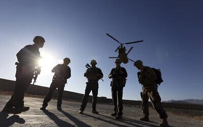 American soldiers wait on the tarmac in Logar province, Afghanistan, November 30, 2017. (AP Photo/Rahmat Gul)