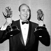 "Carl Reiner shows holds two Emmy statuettes presented to him as best comedy writer for the ""Dick Van Dyke Show,"" during the annual Emmy Awards presentation in Los Angeles, on May 26, 1963.  (AP, File)"
