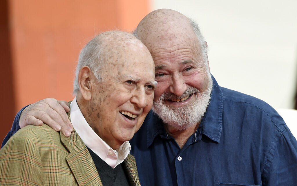 In this April 7, 2017 file photo, Carl Reiner, left, and his son Rob Reiner pose together following their hand and footprint ceremony at the TCL Chinese Theatre in Los Angeles. (Chris Pizzello/Invision/AP, File)