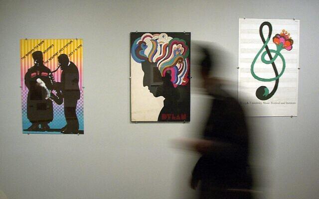 A patron walks by posters by Milton Glaser at the Philadelphia Musem of Art, in Philadelphia, Nov. 9, 2000 (AP Photo/Dan Loh)