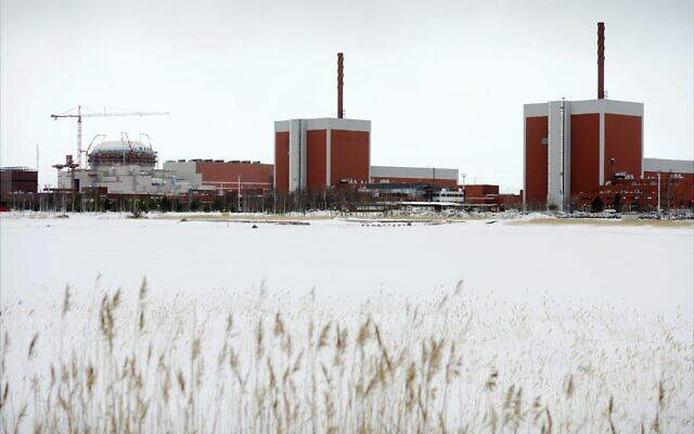 The nuclear power plant Olkiluoto 3 'OL3' under construction next to OL2 and OL1 nuclear reactors in Eurajoki, southwestern Finland, March 23, 2011. (AP Photo/Lehtikuva, Antti Aimo-Koivisto)