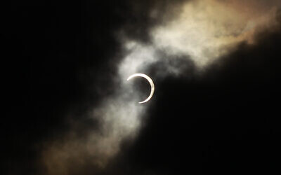 An annular solar eclipse is seen briefly during a break in clouds over Taipei, Taiwan, Monday, May 21, 2012. The annular solar eclipse, in which the moon passes in front of the sun leaving only a golden ring around its edges, was visible to wide areas across the continent.  (AP Photo/Wally Santana)