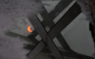 A partial annular solar eclipse is reflected in a pool of water in Beijing, China, Monday, May 21, 2012. (AP Photo/Ng Han Guan)