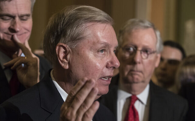 Illustrative: Sen. Lindsay Graham, R-S.C., flanked by Sen. Bill Cassidy, R-La., left, and Senate Majority Leader Mitch McConnell, R-Ky., right, speaks to reporters at the Capitol in Washington, Tuesday, Sept. 26, 2017.  (AP Photo/J. Scott Applewhite)