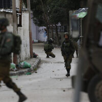 Illustrative -- Israeli troops patrol the streets of the West Bank city of Jenin, January 18, 2018 (AP Photo/Majdi Mohammed)