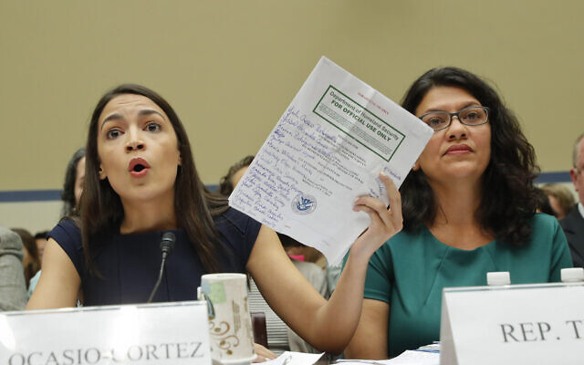 Rep. Alexandria Ocasio-Cortez, D-NY., left, testifies before the House Oversight Committee hearing on family separation and detention centers, Friday, July 12, 2019 on Capitol Hill in Washington. (AP Photo/Pablo Martinez Monsivais)