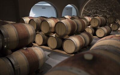Wine barrels sit in a wine cellar in the southern France region of Provence, October 11, 2019. (AP Photo/Daniel Cole)