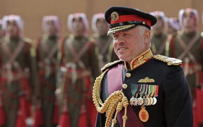 Jordan's King Abdullah II, reviews an honor guard before giving a speech to Parliament in Amman, Jordan, November 10, 2019. (Raad Adayleh/AP)