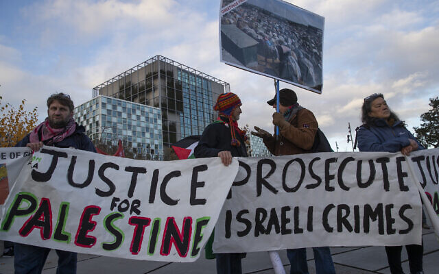 Demonstrators carry banners outside the International Criminal Court, urging the court to prosecute Israel's army for war crimes in The Hague, Netherlands, Friday, Nov. 29, 2019. (AP/Peter Dejong)