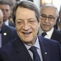 Cyprus' President Nicos Anastasiades, center, at the Ledra Palace Hotel inside the UN controlled buffer zone in divided capital Nicosia, Cyprus, Monday, Feb. 3, 2020. (AP/Petros Karadjias)