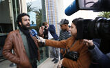Journalist and activist Omar Radi speaks to the media after his hearing at the Casablanca Courthouse, In Casablanca, Morocco, March 5, 2020 (AP Photo/Abdeljalil Bounhar)