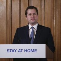 Britain's Housing, Communities and Local Government Secretary Robert Jenrick speaks during a daily COVID 19 coronavirus press briefing to announce new measures to limit the spread of the virus, at Downing Street in London March 22, 2020 (Ian Vogler / Pool via AP)
