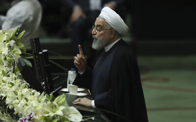 Iranian President Hassan Rouhani speaks during the inauguration of the new parliament in Tehran, Iran, May, 27, 2020. (Vahid Salemi/AP)