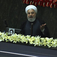 Iranian President Hassan Rouhani speaks during the inauguration of the new parliament in Tehran, Iran, May, 27, 2020 (AP Photo/Vahid Salemi)