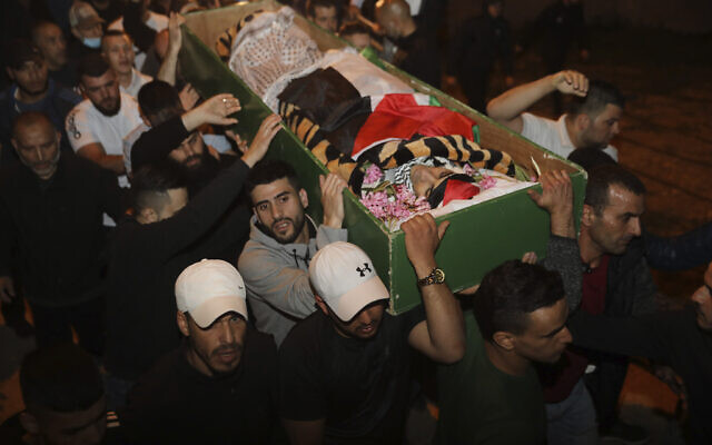Men carry the body of Iyad Halak to burial after Israeli police shot him dead in Jerusalem's old city, Sunday, May 31, 2020, beleiving he was carrying a gun. Israel's defense minister has apologized for the Israeli police's deadly shooting of an unarmed Palestinian man who was autistic. (AP Photo/Mahmoud Illean)