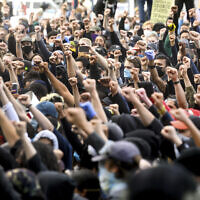 Demonstrators rally in San Francisco on May 31, 2020, protesting the death of George Floyd, who died after being restrained by Minneapolis police officers on May 25, 2020. (AP Photo/Noah Berger)