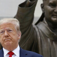 President Donald Trump visits Saint John Paul II National Shrine with first lady Melania Trump on June 2, 2020, in Washington. (AP Photo/Patrick Semansky)