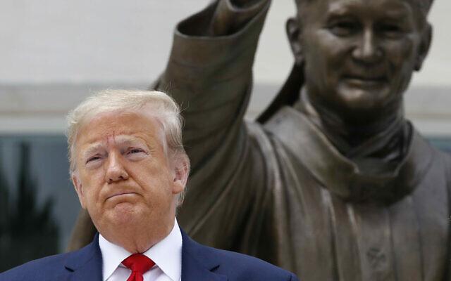 President Donald Trump visits Saint John Paul II National Shrine with first lady Melania Trump on June 2, 2020, in Washington. (AP Photo/Patrick Semansky)