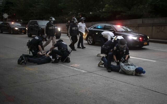 Police arrest protesters refusing to get off the streets during an imposed curfew while marching in a rally calling for justice over the death of George Floyd Tuesday, June 2, 2020, in New York. Floyd died after being restrained by Minneapolis police officers on May 25. (AP Photo/Wong Maye-E)