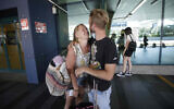 Andrea Monti hugs his girlfriend Katherina Scherf who just arrived from Duesseldorf, Germany at Rome's Fiumicino airport on June 3, 2020. (AP Photo/Alessandra Tarantino)