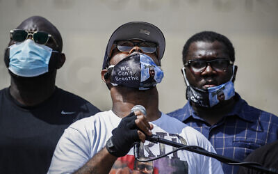 The brother of George Floyd, Terrence Floyd speaks to a crowd during a rally at Cadman Plaza Park, on Thursday, June 4, 2020, in the Brooklyn borough of New York. (AP Photo/John Minchillo)