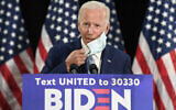 Democratic presidential candidate, former Vice President Joe Biden takes off his mask before speaking during an event in Dover, Delaware, June 5, 2020. (AP Photo/Susan Walsh)