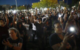 People hold up candles and cell phone lights during a rally June 5, 2020, in Las Vegas, against police brutality sparked by the death of George Floyd, a black man who died after being restrained by Minneapolis police officers on May 25. (AP Photo/John Locher)