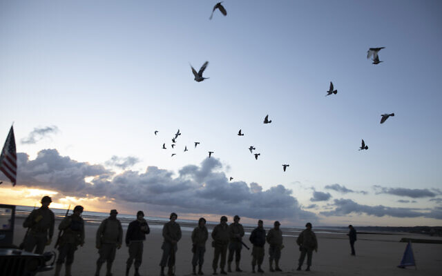 Men in a vintage US WWII uniform watch as pigeons are released during a D-Day 76th anniversary ceremony in Saint Laurent sur Mer, Normandy, France, June 6, 2020 (AP Photo/Virginia Mayo)