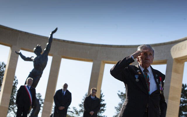 Charles Norman Shay, D-Day WWII veteran and Penobscot Elder from Maine, salutes after laying a wreath during a D-Day 76th anniversary ceremony at the Normandy American Cemetery in Colleville-sur-Mer, Normandy, France, June 6, 2020 (AP Photo/Virginia Mayo)