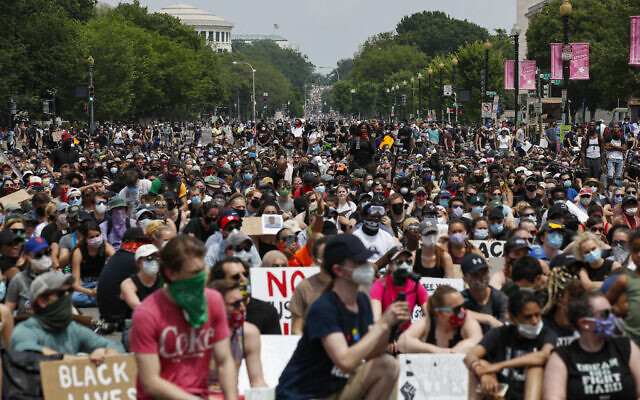 Demonstrators protest on June 6, 2020, in Washington, over the death of George Floyd, a black man who was in police custody in Minneapolis. Floyd died after being restrained by Minneapolis police officers. (AP/Alex Brandon)