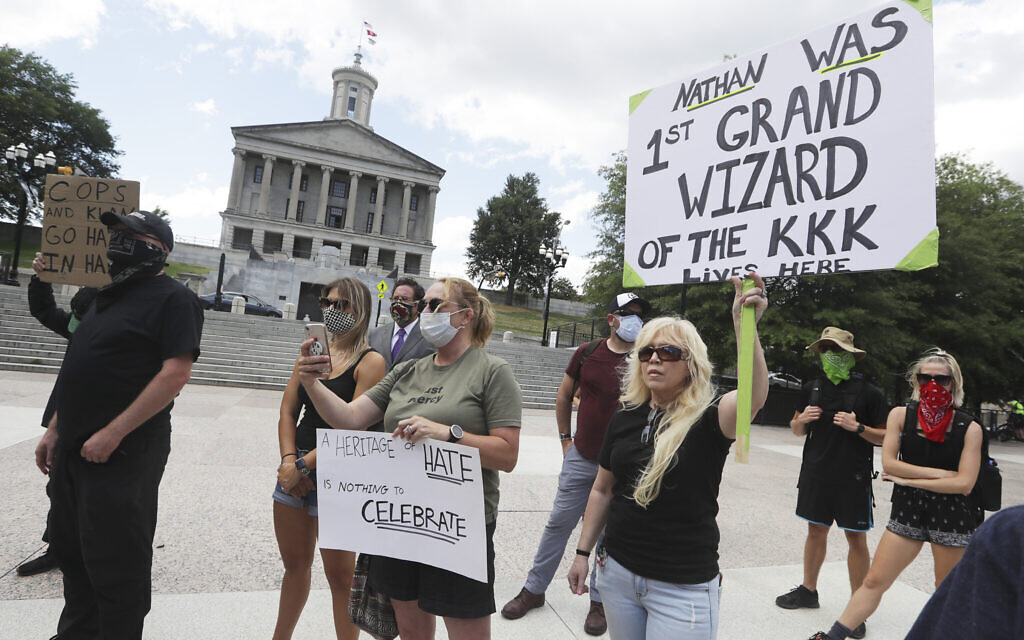 Demonstrators take part in a protest Wednesday, June 10, 2020, in Nashville, Tenn., demanding the removal of a bust of Nathan Bedford Forrest from inside the State Capitol. The bust of the former Confederate general and Ku Klux Klan leader has been the center of controversy for years. (AP Photo/Mark Humphrey)